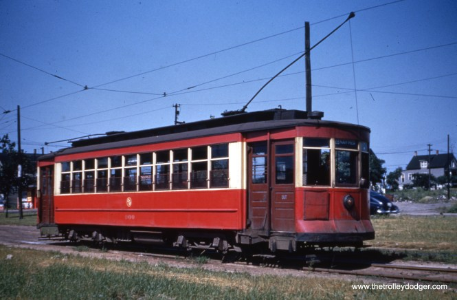 """CTA 900 is signed for route 28 - Stony Island. Bob Lalich notes that the car """"looks to be just south of 93rd St in the Stony Island median. You can see the pole line for the 93rd St line in the right background."""""""