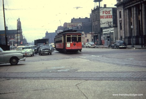 """Andre Kristopans says, """"558 NB Ashland at Roosevelt. Note Roosevelt tracks are spread very wide as west of here was boulevard with car tracks in the service drives. Note also the church in background – still there. In distance is Burlington and CNW underpasses at 15th St."""""""