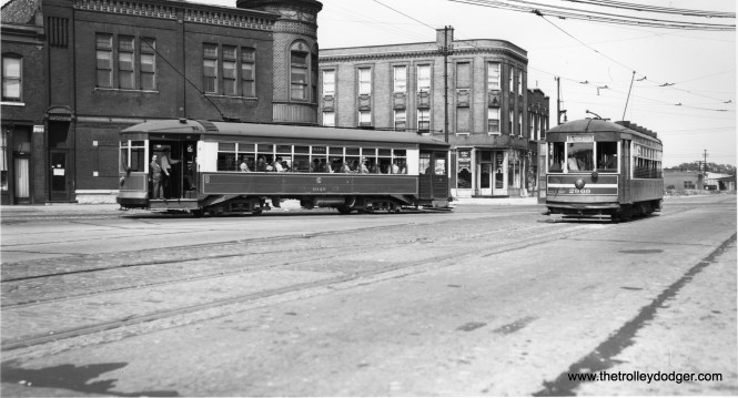 CSL 1949 is eastbound on Grand, and 2909 is westbound on Division. (Joe L. Diaz Photo)