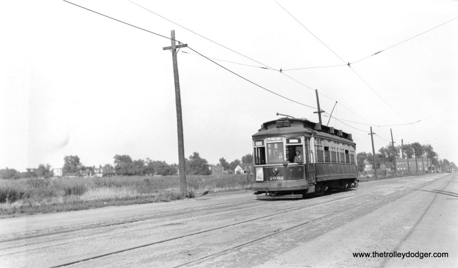 """CSL 2802 is westbound on 119th Street. Andre Kristopans says, """"a block or so west of Morgan, about where the new Salvation Army center now is. Looks like a State/Lake car in the far background at Morgan."""""""