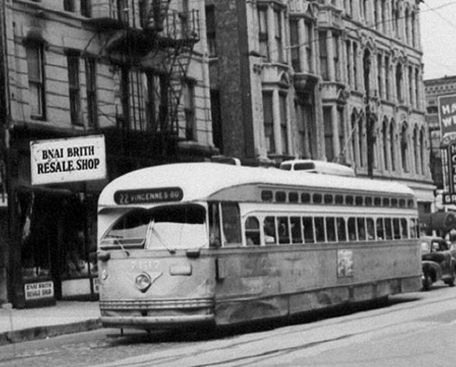 Still in its original colors but a tad worse for wear (as was this photo, I fear) car 7137 passes the B'nai Brith resale shop on North Clark in this August, 1957 shot. I doubt that even the resale shop would want to deal with this car! © Laurence Mack