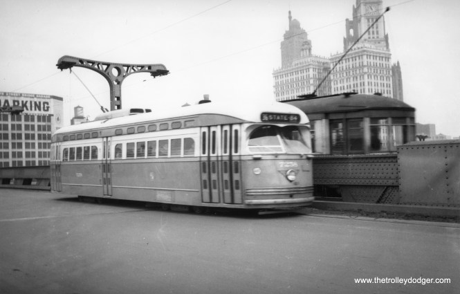 CTA 7258 passes an older car on the State Street bridge. The Chicago Sun-Times building had not yet been built.