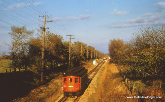 """#67 - JN: 427 eastbound at Gary Siding on Aurora branch EM: CAE 427 (Cincinnati, 1927) pretty much in the middle of nowhere. Probably on the Batavia branch. (Here we have a difference of opinion.) Bob Campbell writes, """"Photographer on the north side of Butterfield Road overpass. Not all of 427 was scrapped – I have one of the end numbers (on the right, retriever side) in my """"Oklahoma Basement"""" (out building)."""""""