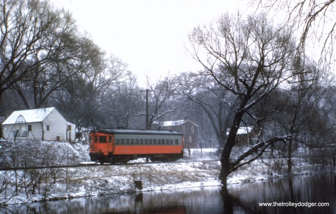 #93 - JN: Westbound on Batavia branch under short section of overhead wire. EM: CAE 457 (St. Louis, 1945) is traveling under wire along the Fox River.