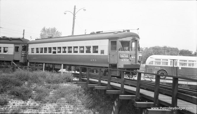 "#16 - CA&E 453 at Des Plaines Avenue terminal in August 1955. Cars 451-460 were ordered in 1941 but delayed by war. They were built by St. Louis Car Co. in 1945-46 and are considered the last ""standard"" interurban cars built in the US, although this is a somewhat debatable point."