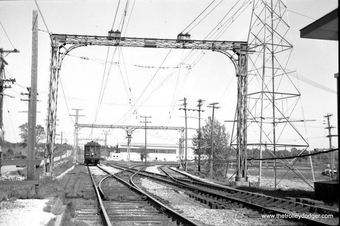 Westbound car 179 at South Upton tower, approaching the crossing with the Chicago and North Western, on June 3, 1960. (Richard H. Young Photo)
