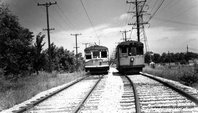 """Speedrail cars 300 and 65, both signed for Hales Corners. According to Don's Rail Photos, """"300 was built by St Louis Car in 1924. #1308. In 1936 it was sold to Cleveland Interurban RR as 300. CI became Shaker Heights Rapid Transit in 1944. It was sold to Milwaukee Rapid Transit & Speedrail in May 1950 as 300. It was scrapped in 1952."""" Car 65 at right is a """"curved side"""" car built by the Cincinnati Car Company. It also came by way of Shaker Heights."""
