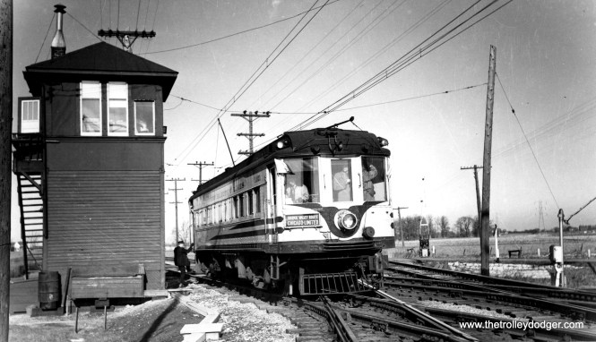 Milwaukee Electric 1121 crosses the Chicago and North Western on a 1949 fantrip over the North Shore Line. It even has a Skokie Valley Route sign on it.