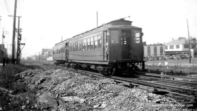 """A two car CRT """"L"""" train in December 1935. The location is given as Austin, but the photo does not indicate whether this is the Douglas Park branch or Garfield. Bill Shapotkin writes: """"I can't tell you where this pic was actually taken, but I can tell you where is was NOT taken. This photo is NOT on Garfield Pk/Westchester. If it were anywhere on that line, the third rail chairs would be the CA&E's wooden third rail chairs -- the chairs shown in this photo are rapid transit third rail chairs. Additionally, if it were """"Austin"""" (on Garfield Pk), we should see the B&OCT next door (and it is not). Now, as for where I think this photo was taken -- there appears to be an interlocking nearby (notice the piping next to outside rail). Thus, I believe the train is WB on DOUGLAS approaching Oak Park Ave (where, if I recall correctly) there was an interlocking. Therefore we would be looking east. At least that is my best guess."""""""