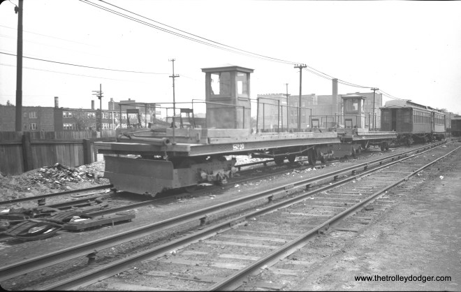 """CRT/CTA snow plow S220 at Laramie on the Garfield Park """"L"""" in 1948."""