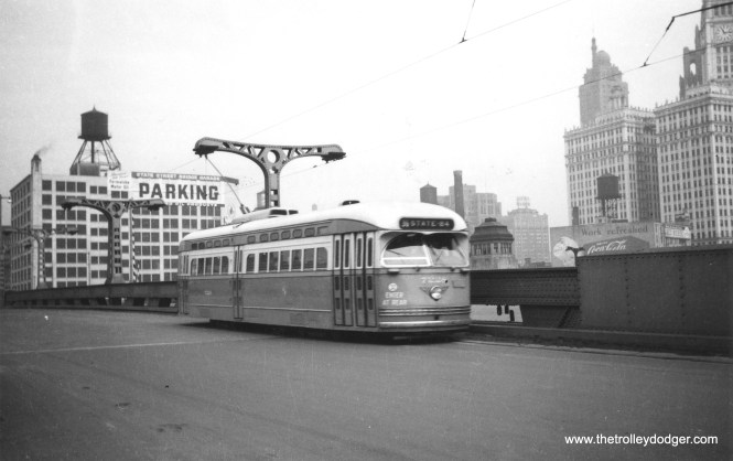 PCC 7228, signed for route 36 Broadway-State, crosses the Chicago River towards the Loop. This car was delivered March 29, 1948, and scrapped March 1, 1957, a service life of about 9 years. (Railway Negative Exchange Photo)