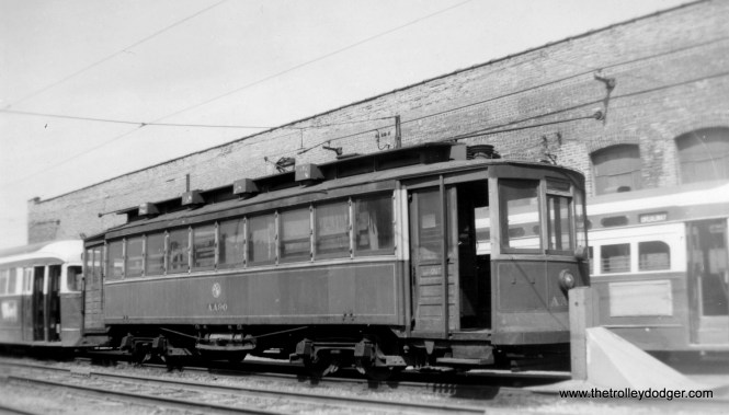 CTA salt spreader AA90, flanked by prewar and postwar PCCs. This work car, originally #1504, was scrapped on September 27, 1956.