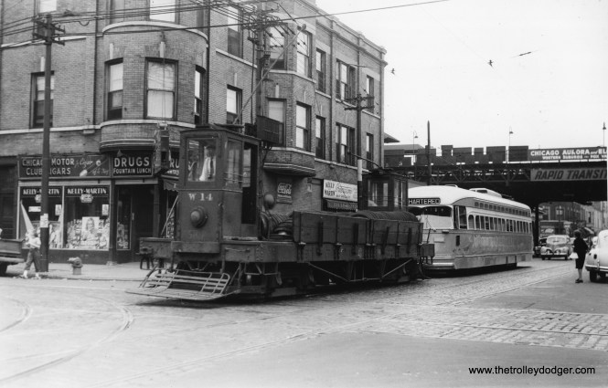 "The general consensus is this PCC, towed northbound at Kedzie and Harrison in 1947, may be going to West Shops for repairs. Note that the Kedzie ""L"" station on the Garfield Park line also served Chicago, Aurora & Elgin interurban trains. (Joe L. Diaz Photo)"