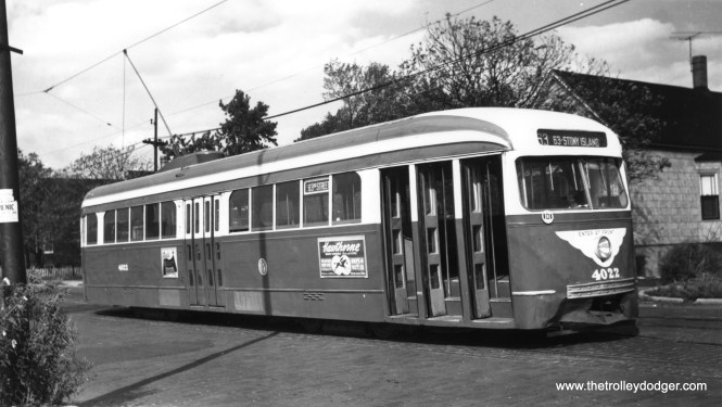 """CTA 4022, with some obvious front end damage, eastbound on the 63rd Street line. There is an ad on the side of the car promoting Hawthorne Race Course, which opened in 1891. One of our readers writes, """"I believe that this car is laying over on the wye at 63rd and Central Park waiting to head east to Stony Island. The car was still two man at the time, but being in Everglade Green, I would date it as mid 1952 before the cars were sent to Cottage Grove after being converted to one-man operation."""" (R. Alexander Photo, Krambles-Peterson Archive)"""