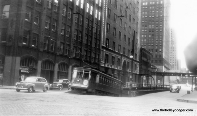 "A Pullman emerges from one of the downtown streetcar tunnels that went under the Chicago River, but which one? George Trapp says ""car 558 (is) emerging from the East end of the Washington Tunnel at Franklin on an inbound Milwaukee Avenue run."" Andre Kristopans notes that the grades in these tunnels were ""VERY steep - something close to 10%. They had very strict rules regarding following distance and speed."""