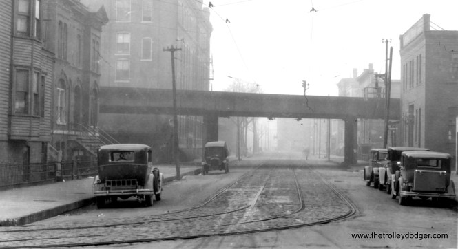 "This is identified as Elm Street looking west at Franklin on December 28, 1928, which makes this the mainline Northside ""L"". George Trapp notes, ""Tracks on Franklin and Elm were not in regular service since at least 1924 if not before, once used as an alternate route for the old Southport-Downtown route. Work cars did use the tracks and had to jump the tracks on Sedgwick and Orleans."""