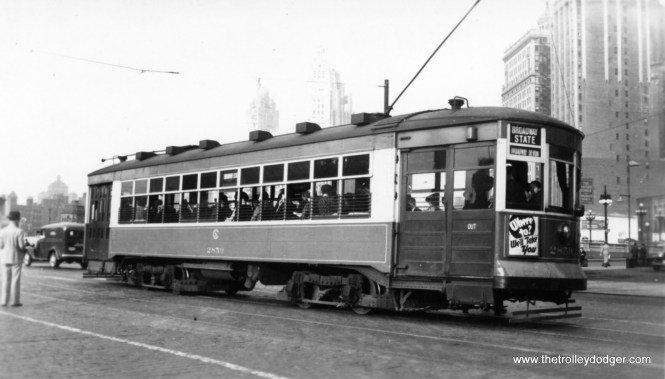 """CSL 2859 northbound on the Broadway-State route, preparing to cross the Chicago River. George Trapp: """"CSL Car #2859, this car was the only modern steel car owned by the Calumet & South Chicago, it was a four motored two man car with a body constructed like an MU car with same trucks as 169 Class. Northbound on Broadway-State before old State Street bridge taken out of service during 1939."""" (Edward Frank, Jr. Photo)"""