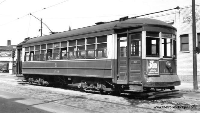 """CSL 1531 on July 14, 1947. George Trapp writes: """"CSL 1531 is at North end of Taylor-Sedgewick-Sheffield line at Sheffield and Clark a month before conversion to bus."""" Another reader writes: """"Sheffield at Clark (looks the same today, no transit service on Sheffield anymore), was the Taylor-Sedgwick-Sheffield car line."""" (Gordon Lloyd Photo)"""
