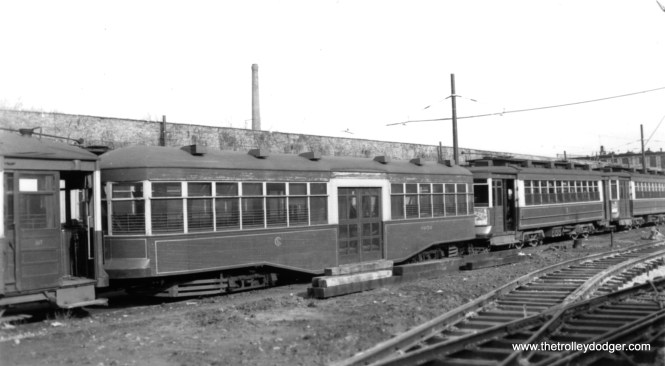 """George Trapp: """"CSL Trailer 8050 is also at Devon Depot, Note new track in foreground, car is sandwiched between a Big Pullman and a 169 class car."""" The trailer was built in 1921."""