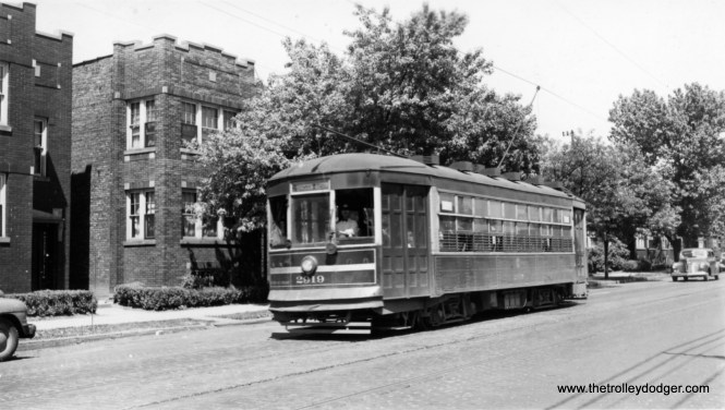 """CSL 2910 heading west (signed for Austin, the city limits) in the 1940s. George Trapp: """"CSL 2910 is on West Division line, Destination reads Division-Austin, this type of car a regular on this route."""" From our comments section: """"CSL 2910 is signed DIVISION-AUSTIN. Short line operated on Division between Grand and Austin until it was through routed by bus to California until it was further through routed to downtown."""" """"CSL 2910 heading west (signed for Austin, the city limits) possibly Division / Austin … location is possibly on Division just east of Grand ave."""" Andre Kristopans: """"2910 is most likely on West Division St, California to Austin, as it is a small one-man car."""" Mike Franklin: """"CSL 2910 heading west and the two flats are located on the 5000 block of Division."""""""