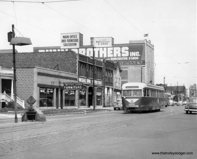 """CTA 4009 is on route 4 - Cottage Grove, circa 1952-55. Patrick writes, """"Photo 981 is in the 6700 block of (south) Cottage Grove, looking north. The one story Michael Dunn building still exists, as does the biggest building (now a self storage facility). This is across the street from Oak Woods Cemetery."""""""