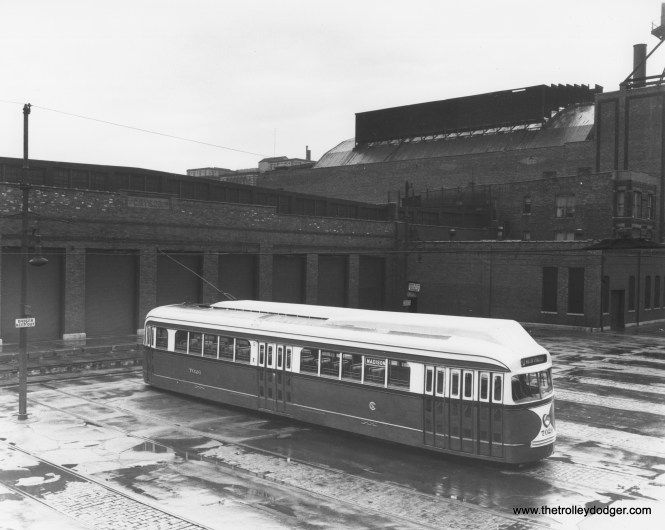 """PCC 7026 at West Shops, temporarily fitted with experimental roof-mounted forced air ventilation, of a type that was used in Boston, but did not find favor in Chicago. (CSL Photo) Chuck Amstein adds, """"The large building behind the shop building is the back of the Paradise Theatre, 231 N. Crawford/Pulaski. It was one of the last big movie palaces built in Chicago (1928) and one of the first to be torn down (1956)."""""""