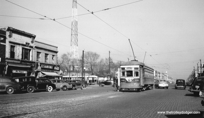 Chicago & West Towns Railways car 130 is at the east end of the Madison line on March 31, 1946, while a Chicago Surface Lines prewar PCC sits nearby at the Madison-Austin loop. This is the borderline between Chicago and suburban Oak Park. (Don Ross Photo)