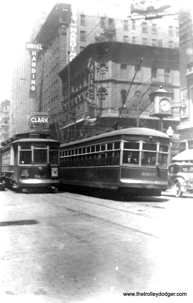 "CSL 5209 and 3367 pass on Clark just north of Madison in 1935. That is the famous Clark Theatre in the background, later made famous in the song ""Werewolves of London"" by Warren Zevon. (Edward Frank, Jr. Photo)"