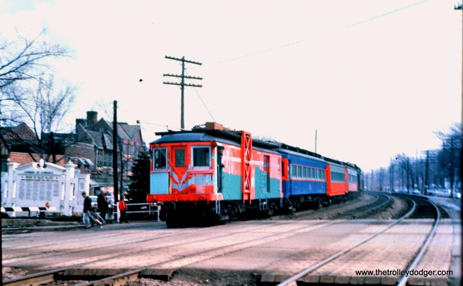 "This must be the April 1962 train taking CA&E equipment purchased by RELIC, the predecessor to the Fox River Trolley Museum. According to Don's Rail Photos, ""11 was built by Brill in 1910, (order) #16483. It was rebuilt to a line car in 1947 and replaced 45. It was acquired by Railway Equipment Leasing & Investment Co in 1962 and came to Fox River Trolley Museum in 1984. It was lettered as Fox River & Eastern."" This picture was taken in Glen Ellyn along the C&NW. (Mark Llanuza Collection)"