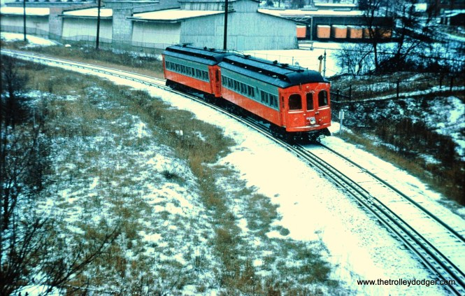 320-319 near the Corrugated Box Company on the Elgin branch, December 7, 1958. (Mark Llanuza Collection)