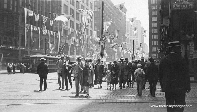 "This picture, and the next, appear to have been taken in the late 1920s or early 1930s. The banners would indicate an event, but we are not sure of the occasion. One of our readers says this is ""State and Washington looking south."" This could also be circa 1926 at the time of the Eucharistic Congress."