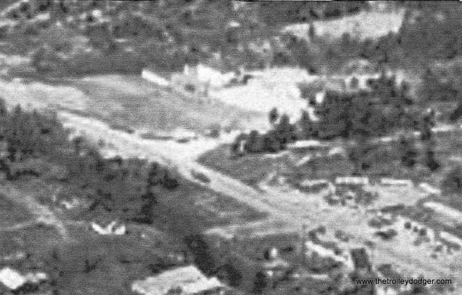 An aerial photo, probably from the late 1940s, where you can just barely make out (at right) some of the streetcars in the Trolley Motel.