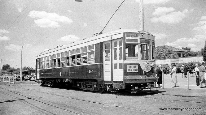 Chicago & West Towns 140, sister car to the 141 now operating at the Illinois Railway Museum, at the south parking lot of the Brookfield Zoo in the 1940s.