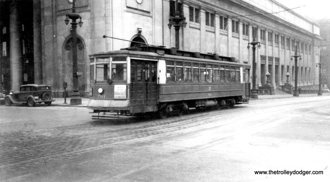 """Although the photo says this is Madison, that sure looks like Chicago Union Station, which means car 701 is probably on Adams instead, heading east. (B. H. Nichols Photo) Bob Lalich: """"I agree with your comment, car 701 is passing CUS on Adams."""" Andre Kristopans: """"701 should be on Adams EB at Canal."""""""