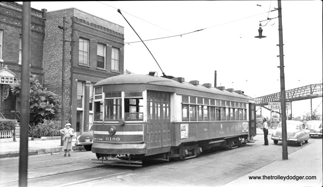 CTA 6180 is at 43rd and Oakenwald on August 8, 1953, the last day of streetcar service on the 43rd-Root Street line. Note the Illinois Central station at rear. (C. Edward Hedstrom Photo)