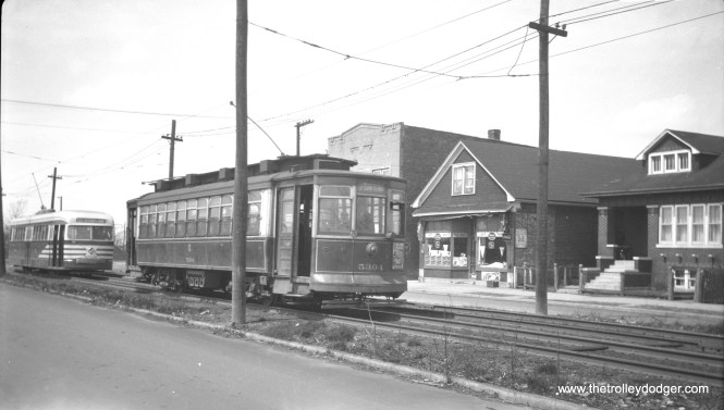 CTA 5304 is eastbound on the private right-of-way at the west end of route 63, followed by prewar PCC 4002. Note how 5304 is using the front trolley pole, reversed. (R. J. Anderson Photo)