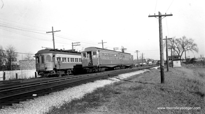 """CA&E 314 and CTA 2833 at Laramie on March 12, 1953. I'm not sure whether the 314 is on a storage track. The photographer notes, """"this section to be abandoned by CA&E."""" The interurban cut back service to Forest Park that September 20th. I believe we are looking east. (Roy Bruce Photo)"""