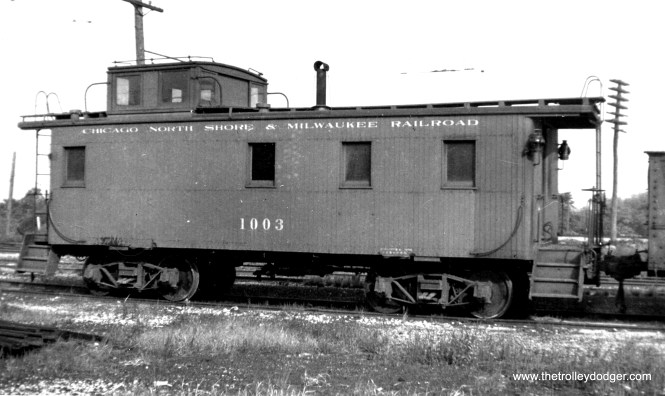 "Don's Rail Photos says that North Shore Line caboose 1003 ""was built by American Car & Foundry Co in 1926. It was rebuilt without a cupola but restored when it was acquired by IRM."" There was some discussion recently on a Yahoo group concerning CNS&M cabooses. Someone was interested in making a model, and this nice side view should help determine the dimensions."