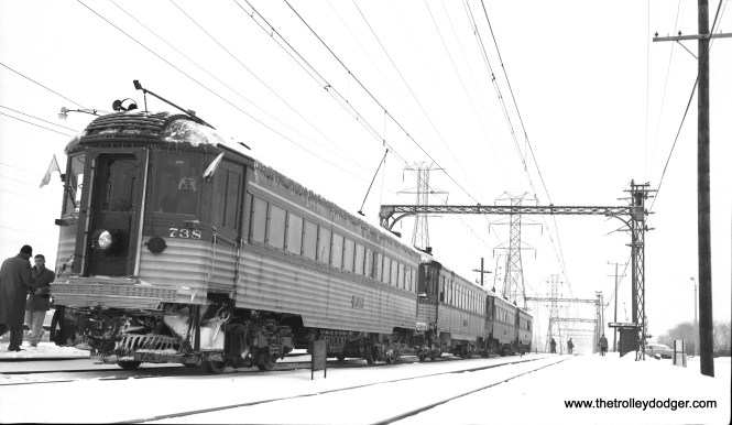 CNS&M Silverliner 738 heads up a four-car special train making a station stop at Northbrook during a snowstorm in February 1960. (Richard H. Young Photo)