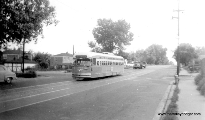"""In this August 1955 view, CTA 7106 is apparently heading northbound on route 36 - Broadway-State. Andre Kristopans adds, """"7106 is NB at State and 91st about to go under C&WI/BRC/RI bridges. Note how street slopes downward. Everything on the right is gone, replaced by Dan Ryan Expressway."""" (Roy W. Bruce Photo)"""