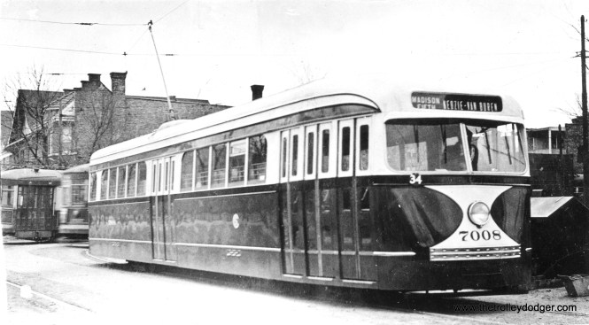 Although CSL prewar car 7008 is signed for Madison-Fifth, this photo appears to show the Madison-Austin loop. PCCs are probably being phased in late 1936 or early 1937, as evidenced by the older cars in the photo. Once the route was equipped with 83 PCCs, they still required a number of the fast 1929 Sedans to fill out the schedules. Those buildings in back are still there today. Maybe it's just a pull-in heading back to Kedzie Station. The car still has some shine on it.