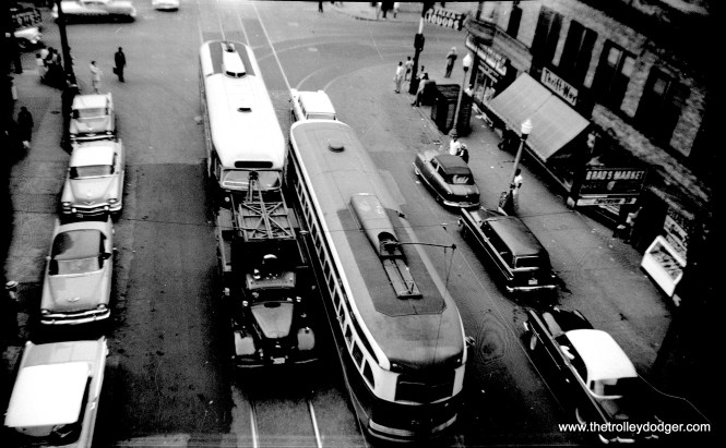 """This picture, most likely taken from an """"L"""" platform, gives an excellent view contrasting the roof treatments on these two PCCs. 7203 is at right, in regular service, while the other car is being towed."""