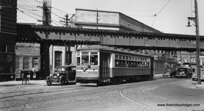 """CSL 3304 is westbound at Armitage and Campbell on route 73, having just passed under the Logan Square branch on the """"L"""". That looks like a Model A Ford at left."""