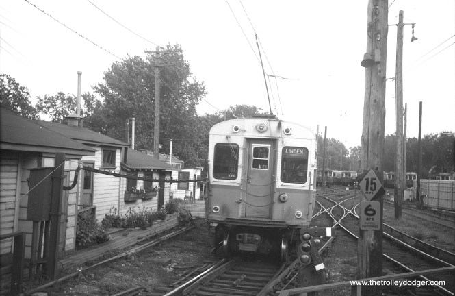 "A CTA single car unit running under wire at the Linden terminal in Wilmette in 1964. We are looking south. The Evanston branch was changed over to third rail along with the retirement of 4000-series ""L"" cars in 1973."