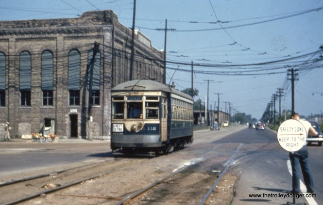 Chicago & West Towns Railways car 112 heads south at Harlem and Cermak on August 17, 1947.