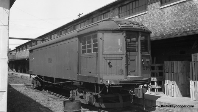 """According to Don's Rail Photos, Chicago North Shore & Milwaukee 213 """"was built by Cincinnati in March 1920, #2445, as a merchandise dispatch car. In 1940 it was rebuilt as a disc harrow ice cutter. It was retired in 1955 and sold to CHF as their 242. It was donated to Illinois Railway Museum in 1964."""" This photo by the late Bob Selle shows it newly delivered to the Chicago Hardware Foundry in North Chicago on August 7, 1955."""