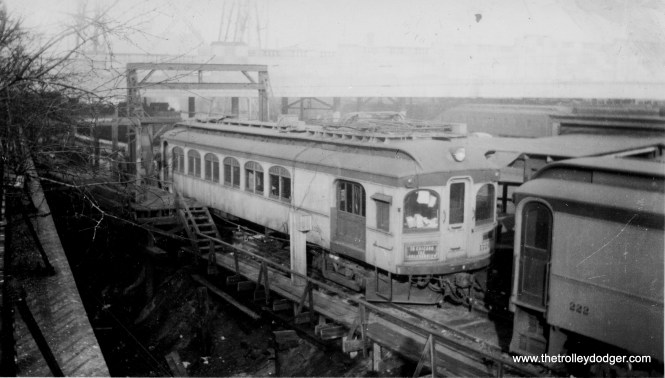 """This rare photo of South Shore Line car 1126, signed """"To Chicago, the Boulevardier,"""" is dated February 14, 1939, although I do not know whether that is the date the picture was taken, or when it was printed. Incredibly, this car survives. As Don's Rail Photos notes, """"1126 was a work motor built by Niles in 1908 as CLS&SB 73. In 1927 it was rebuilt into work motor 1126. In 1941 it was sold and converted to a house. In 1994 it was purchased for restoration from a buyer who had picked it up the month before for back taxes. He really did not want the car, just the land. Bob Harris began restoration in 2005..."""" According to a 2015 Chicago Tribune article, the car is now in Murphysboro, Illinois, and is 80% restored."""