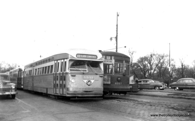"""It's November 14, 1948, and CTA PCC 4341 and its follower are on Southport at Clark Street, the north end of the #9 Ashland route-- a very unusual place for PCCs to be. That's Graceland cemetery on the east side of Clark. Andre Kristopans writes, """"The Clark PCC's parked on Southport are Cubs extras. Would have come down from Devon (note CLARK-LAWRENCE sign), and would be put away on normally-unused track on Southport. When game would let out, they would be backed back out onto Clark, and sent south."""" Which all sounds very plausible except for the date of the photograph. But as Andre pointed out in a later note, on November 14, 1948 the Chicago Bears played the Green Bay Packers, and that game took place in Wrigley Field. So these PCCs are being held back until the end of the game. The Bears won that day, 7-6."""