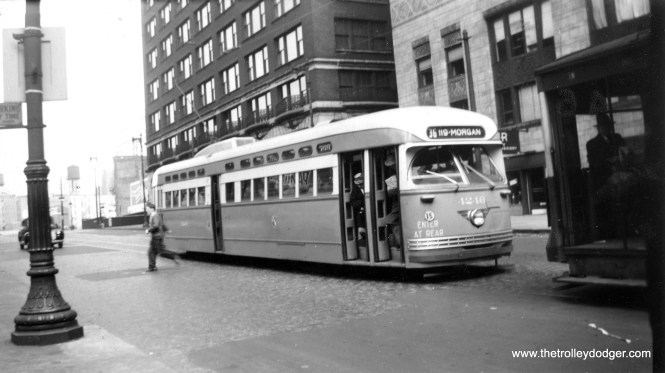 """Someone's just gotten off CTA PCC 4246 via the middle door on October 8, 1948. The car is heading southbound on route 36 - Broadway-State and is just north of Lake Street in this Mervin E. Borgnis photo. Borgnis wrote a number of different railfan books, and at one time worked as a motorman for the Lehigh Valley Transit Company in Allentown, Pennsylvania. Jim Huffman writes: """"It does not look like State St, to me it looks like Wabash. The Broadway-State route used Wabash as a detour until the State St bridge was constructed. The new bridge was Dedicated on 5/28/1949, which precludes it being on State."""""""