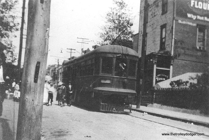 "Photo caption: ""Penn Central Railway #2 at the end of line (in) South Fork. Note motorman raising trolley to wire from window. These were center door cars. 1918."""